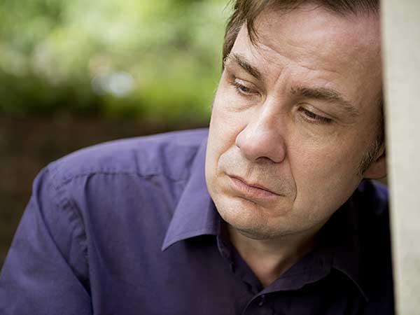 Man exhibiting symptoms of Complex PTSD.