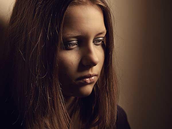 Sad teenage girl.