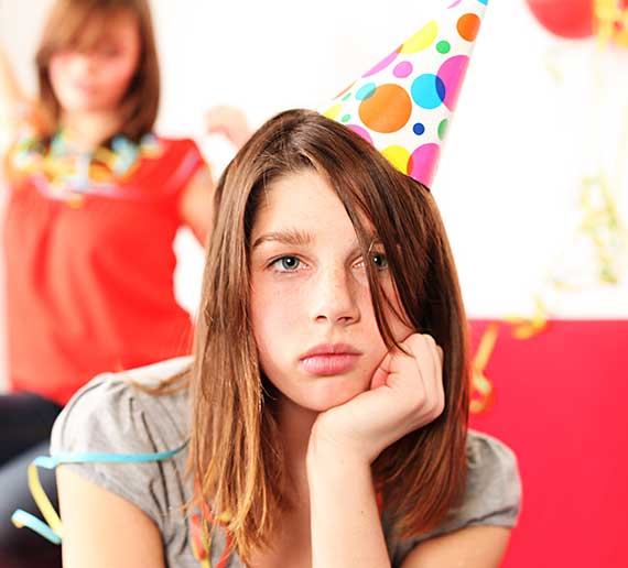 Sad girl at birthday party
